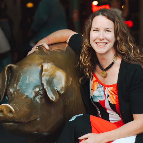 Patricia Gray posing with Rachel the Pig