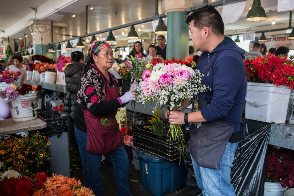 In this Market Story: Scott and Chue Change prepare bouquets.
