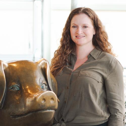 Sarah Mills standing next to Billie the Pig