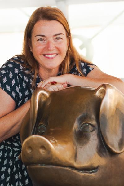 Natasha standing next to Billie the Pig